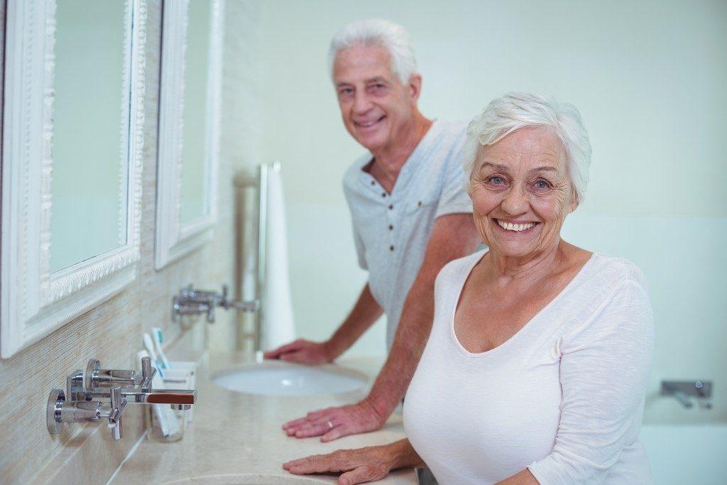 Senior couple at the bathroom