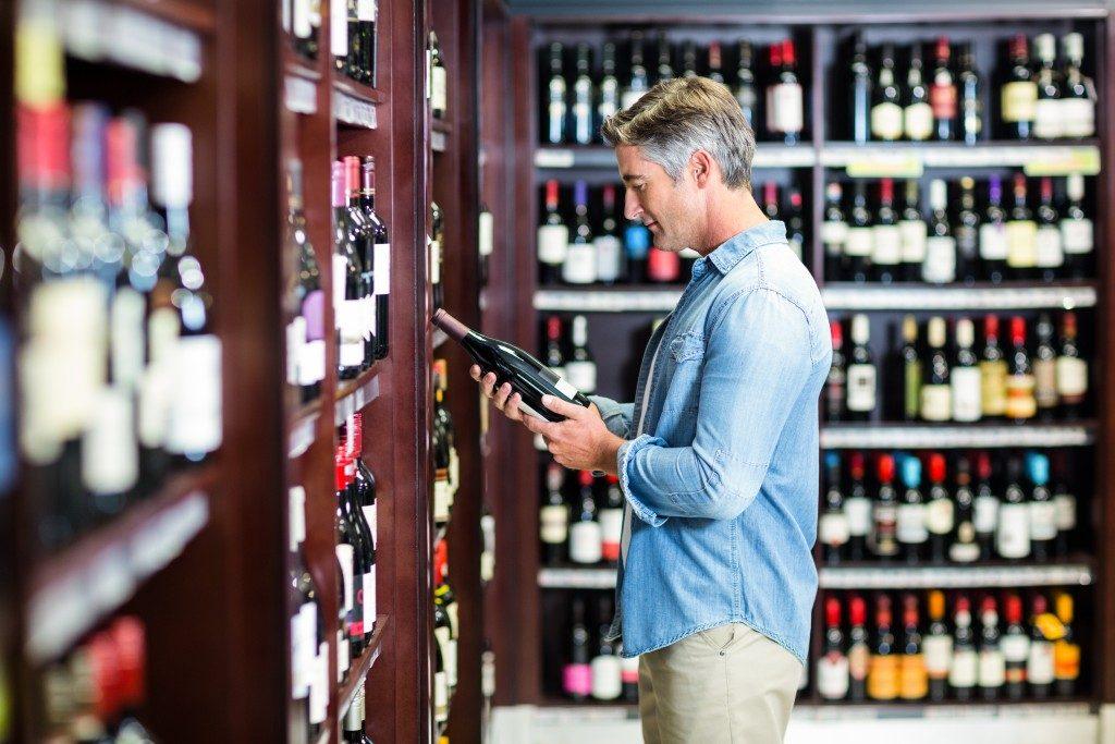 Man buying alcohol