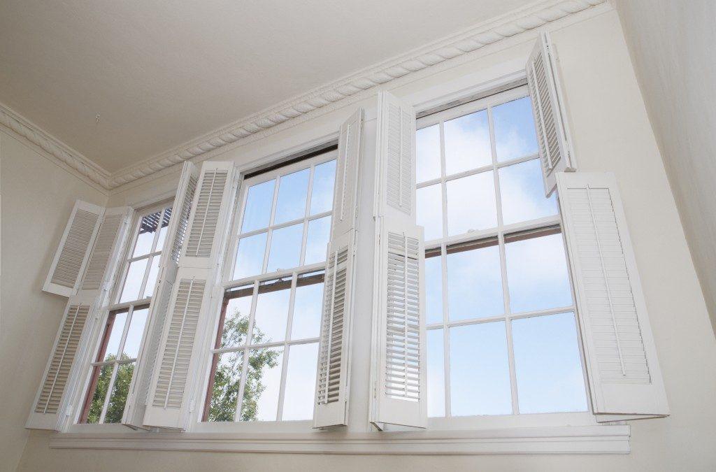 Sky seen through Sky seen through plantation shutter windows