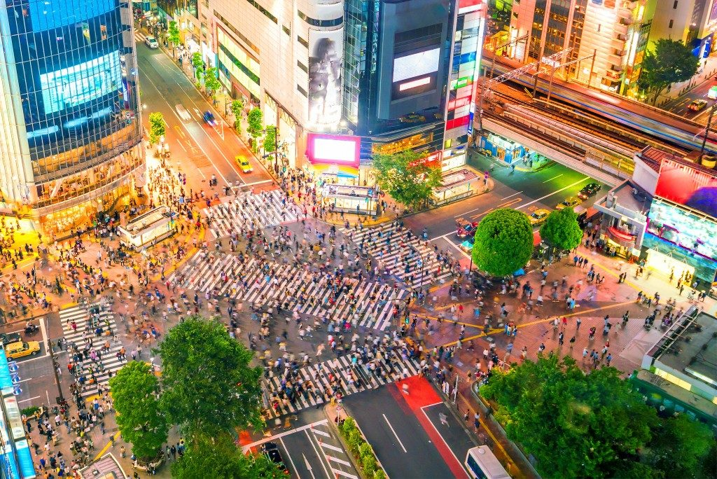 Shibuya Crossing from top view at twilight in Tokyo