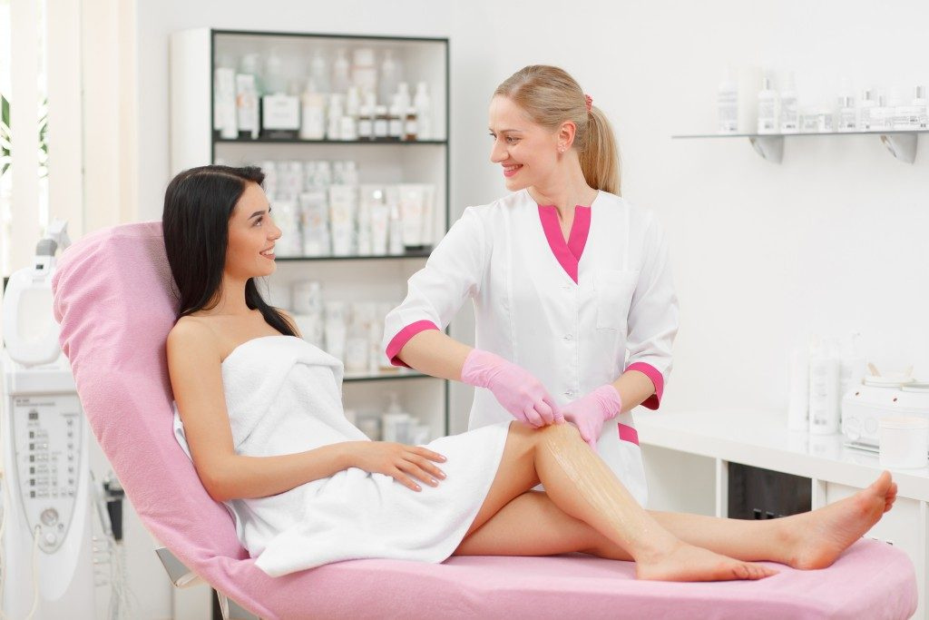 aesthetician and customer in a waxing salon