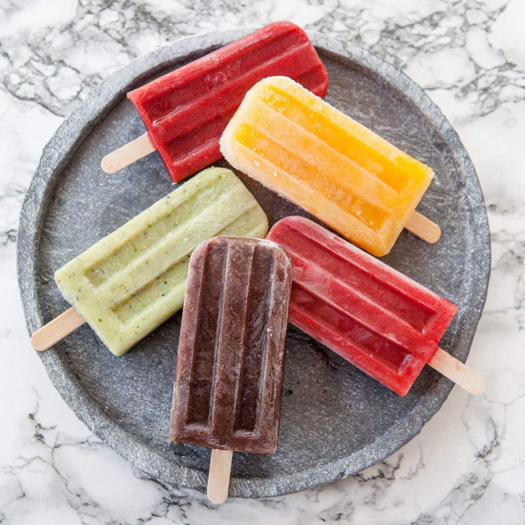 Homemade frozen ice cream popsicles in various flavors