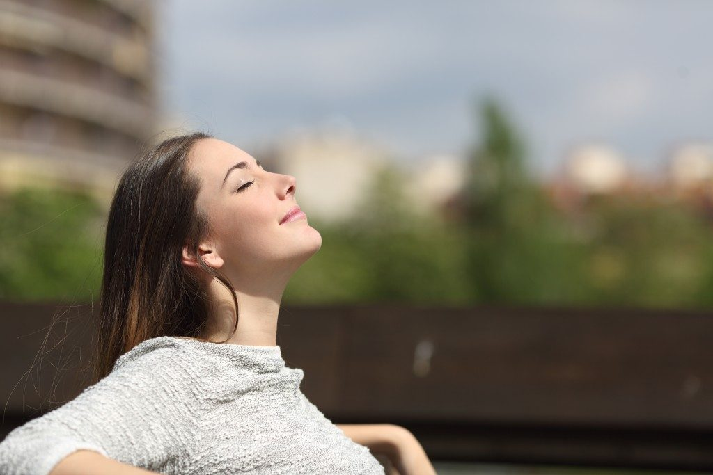 woman relaxing under the sun