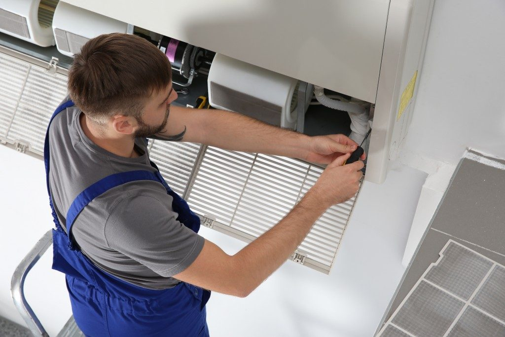 Technician fixing humidifier