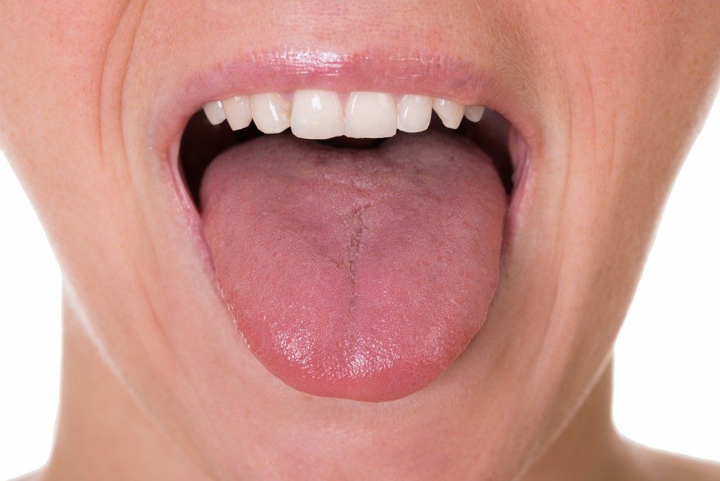 woman showing her tongue