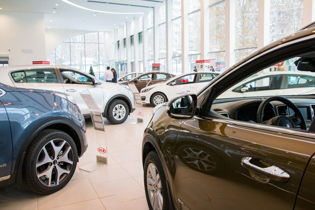 different cars inside the automobile showroom