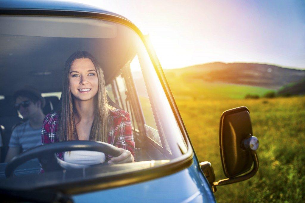 woman smiling while driving van