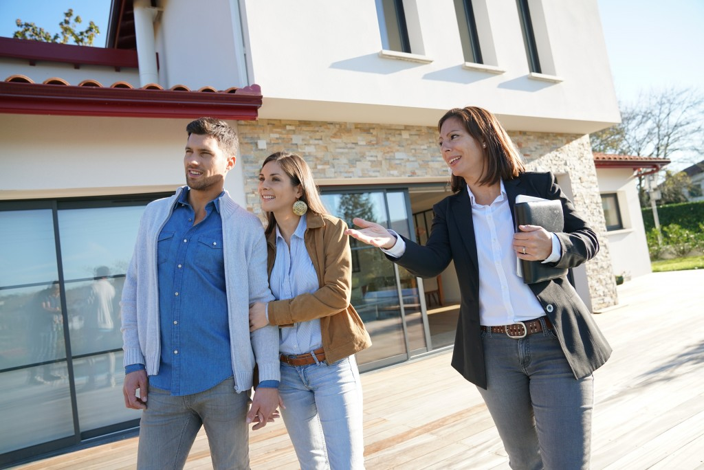 couple visiting the property they want to buy