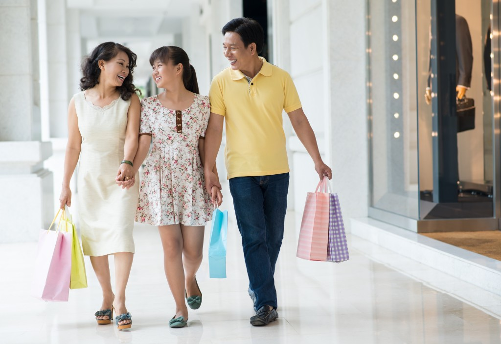 asian family out for shopping