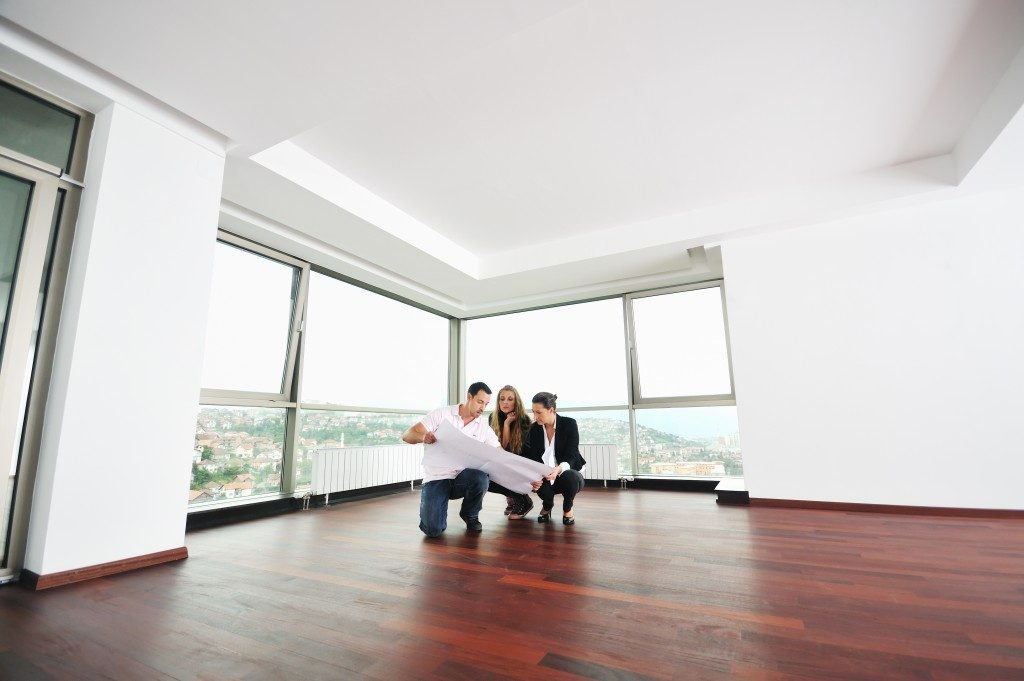 Couple looking at their new floor plan