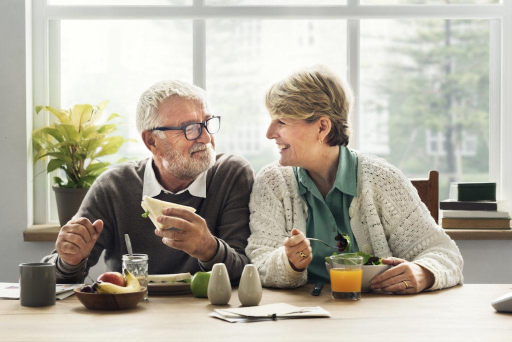 senior couple eating together