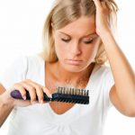 woman experiencing hairloss