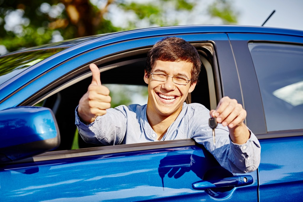 young man with new car