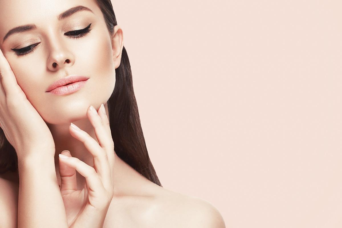 woman touching her skin