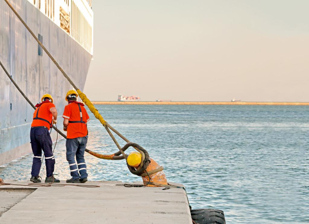 men near a boat